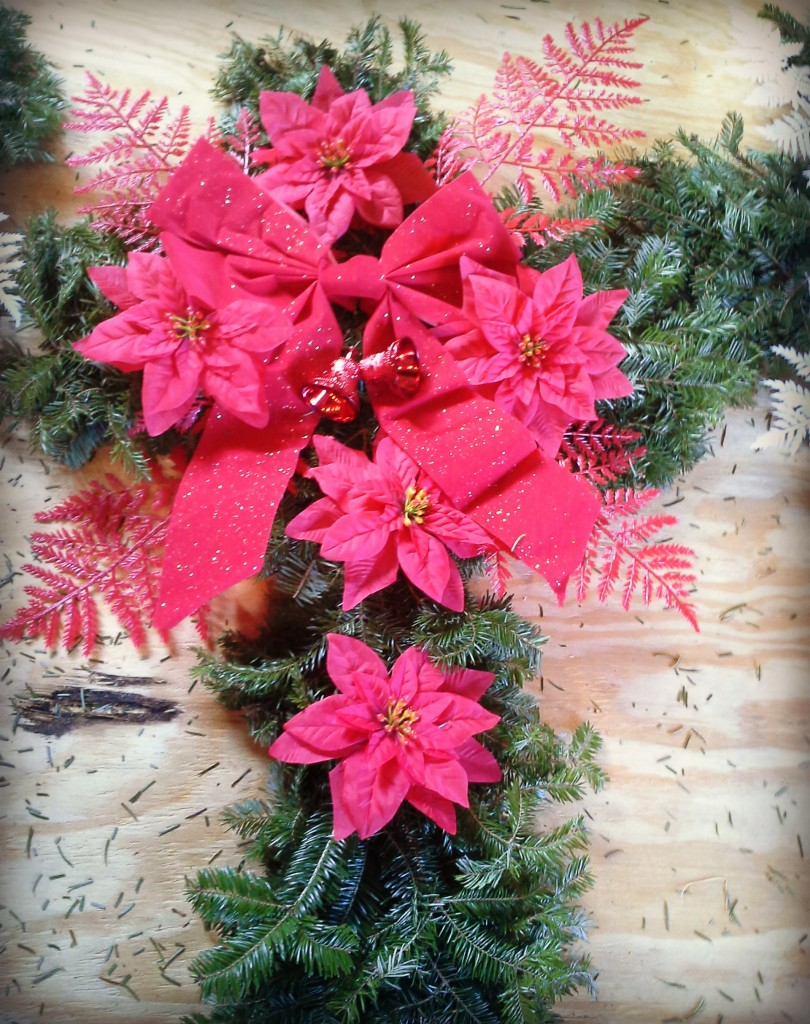 Here's a cross shape done in all red decorations.